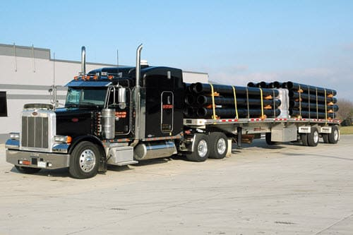 flatbed hauling pipe